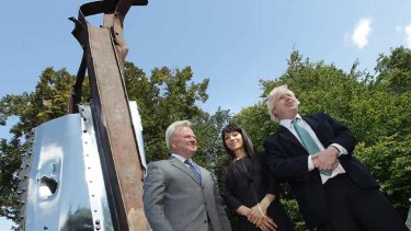 Boris Johnson (R) unveils a sculpture    made from the remains of The World Trade Center.