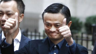 Thumbs up: Alibaba boss Jack Ma poses outside the New York Stock Exchange. But buying into the Chinese e-commerce stock is not without risks.