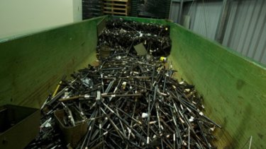 Deadly destruction... firearms are dismantled and destroyed at an undisclosed Sydney police station.