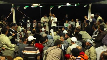 A crowd gathers for a meeting at the stern of the MV Marmara passenger boat, part of the Free Gaza flotilla.