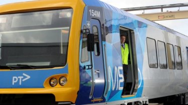 Minister for Transport Terry Mulder on one of the new X'Trapolis trains.