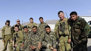 Suspicion ... members of the 6th Battalion of the Afghan National Army with Australian soldiers at the Sorkh Bed compound.