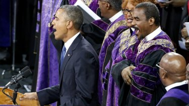 Barack Obama leads mourners at Reverend Clementa Pinckney's funeral in singing the song Amazing Grace in June.
