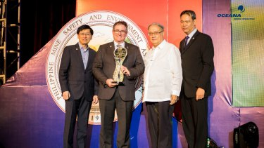 OceanaGold chief executive Mick Wilkes is presented with the Presidential PMIEA award in November 2016 at a ceremony held in the Philippines.