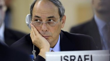 Israel's Ambassador to the UN, Eviatar Manor, listens to a statement at the United Nations Human Rights Council at the UN headquarters in Geneva.