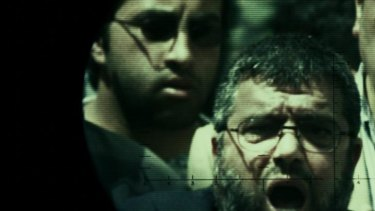 Behind the wire: Mosab Hassan Yousef (left) and his father Sheikh Hassan Yousef, one of the founders of Hamas.