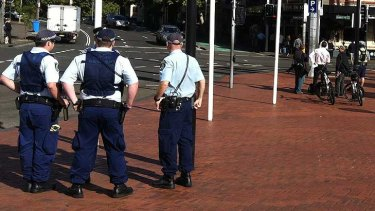 Police were out in force today at the end of Pyrmont Bridge in Sydney.