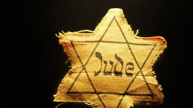 A cloth star with the word 'Jude', German for Jew, that Jews had to wear during the Nazi occupation.
