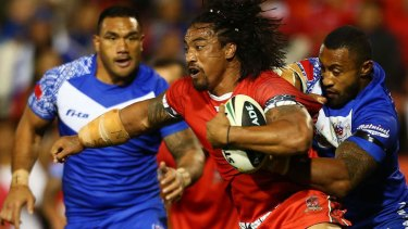 Crash ball: Fuifui Moimoi of Tonga runs into the Samoan defence.