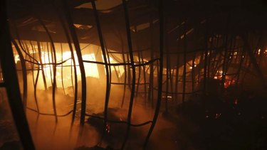 A fire burns inside a garment factory in the Bangladeshi town of Gazipur. Nine employees died in the blaze.