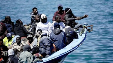 A boat with more 200 people aboard arrives from Libya on the italian island of Lampedusa. About 26,000 undocumented migrants have arrived in Italy this year, including some 21,000 who said they were from Tunisia.