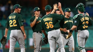 Team Australia players celebrate their monumental upset of the Arizona Diamondbacks.