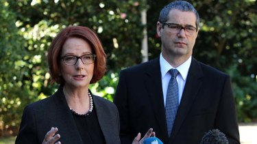 Labor said it would restrict the spruiking of odds but allow advertisements to air: Prime Minister Julia Gillard and Communications Minister Stephen Conroy.