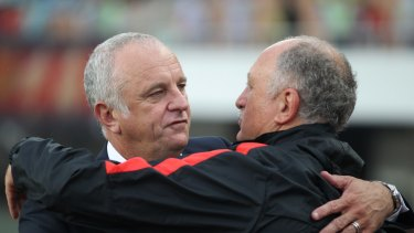 Respect: Sydney FC coach Graham Arnold and his Guangzhou Evergrande counterpart Luiz Felipe Scolari embrace during the game in Guangzhou on May 3 .