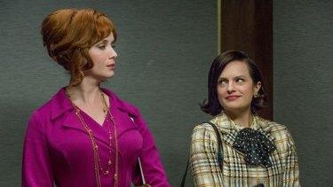 Joan Harris (Christina Hendricks) and Peggy Olson (Elizabeth Moss).