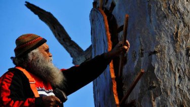 Building a bark canoe from a redgum tree. <i>Picture: Justin McManus</i>