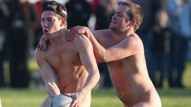 Nude students play rugby in Dunedin, New Zealand.
