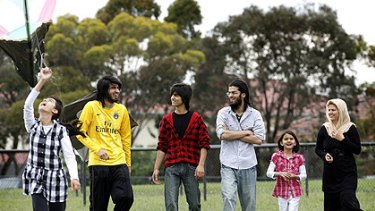 The Hasmat family, refugees from war-torn Afghanistan, are making their mark in Australia. From left: Maryam, Poya, Solaiman, Shaheen, Madina and mother Shaiqu.