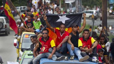 """""""Shifting from authoritarian rule to democracy brings its own challenges"""" ... Fretilin supporters parade down the streets of Dili, Timor-Leste."""