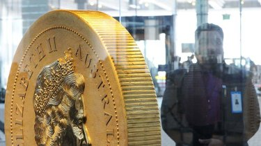 A security guard watches over the $1 million coin -- the biggest and heaviest in the world -- at the Commonwealth Heads of Government Meeting in Perth.