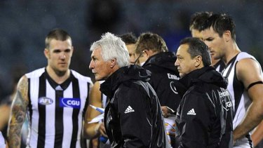 Master tactician: Collingwood coach Mick Malthouse issues instructions at the end of the first quarter against Port Adelaide.