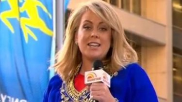<i>Sunrise</i> host Samantha Armytage announcing the trip from on top of a camel in Martin Place.