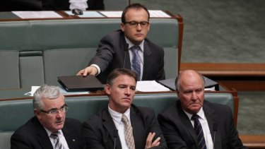 Independent MPs Andrew Wilkie, Rob Oakeshott and Tony Windsor listen as MPs debate the bill. Photo: Alex Ellinghausen