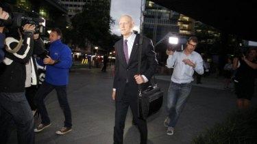 Peter Garrett leaves the home insulation inquiry in Brisbane.