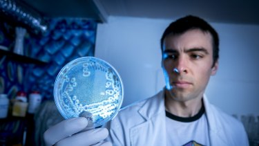 Mr Gray with bacteria samples at a lab in Brunswick.