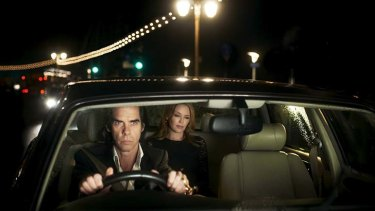 VIP passenger: Nick Cave drives Kylie Minogue in a scene from the documentary 20,000 Days On Earth, set to open the Sydney Film Festival.