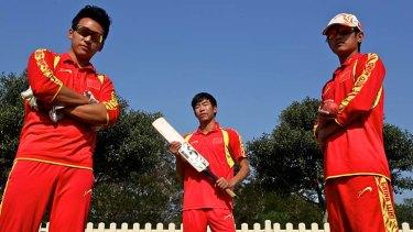 Spirit of Confucius ... cricket ambassadors Jason Zhao, 19, Zhang Peng, 26, and William Wang, 18, at Bankstown Oval.