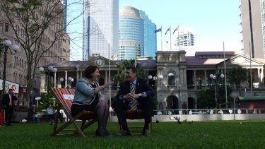 Brisbane Councillor Vicki Howard and Lord Mayor Graham Quirk test out the deck chairs.