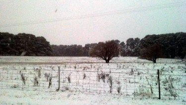 A blanket of white covers a field in Orange.