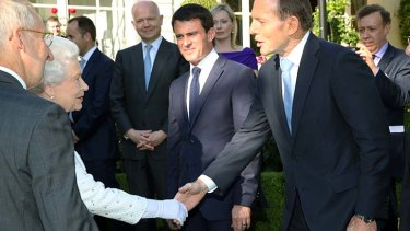 Mr Abbott greets Queen Elizabeth II at the event in France.