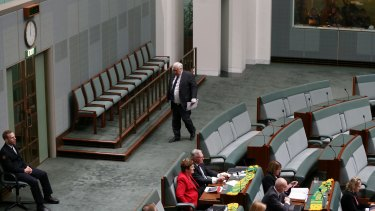 Palmer United Party leader Clive Palmer leaves question time at 2.55 pm on Thursday.