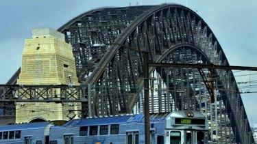 A train nears the iconic Harbour Bridge.