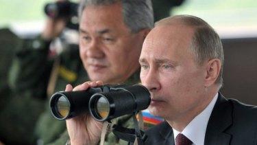 Flexing military muscle: Russian President Vladimir Putin.