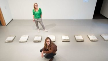 Curator Geraldine Barlow and artist Saskia Doherty with Saskia's work, part of Monash University Museum of Art's <i>Concrete</i> exhibition.
