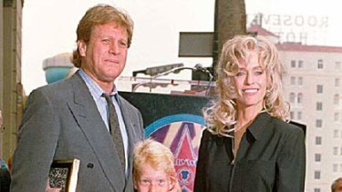 Family time ... Ryan O'Neal and Farrah Fawcett with their son Redmond in 1995.