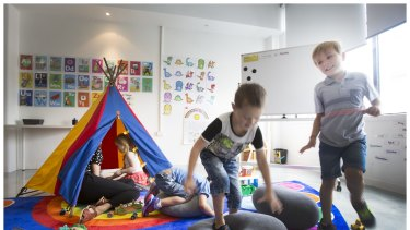 Bailey and Jack test their balancing skills on a soft cushion with other children who all attend a new preparatory school program for children with autism. The Little School is the first of it's kind in Australia.