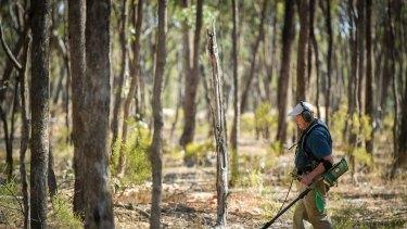 Retired banker from NSW John Nalder searches for gold.