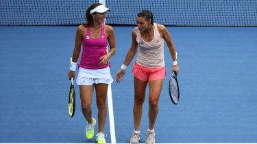 Martina Hingis and Flavia Pennetta are into the women's doubles semi-finals at the US Open.