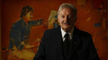 Composer Peter Sculthorpe with a portrait by Eric Smith that forms part of the exhibition at the National Portrait Gallery in Canberra.