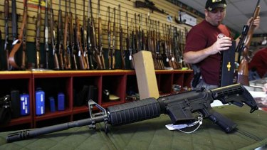 Despite Wall Street plunging, US investors sent gun stocks soaring after Barack Obama's re-election.