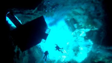 Divers in the Kilsby Sinkhole, which claimed the life of a Victorian man on Saturday