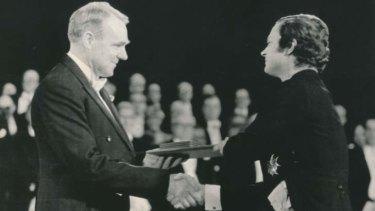 Big moment: John Cornforth receives the Nobel prize for chemistry from King Carl XVI Gustav.