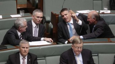 Independent MPs Andrew Wilkie, Craig Thomson, Rob Oakeshott and Tony Windsor talk during the motion of no confidence during question time.