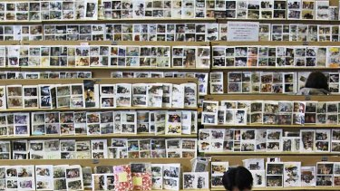 A year later … looking for personal photographs at a tsunami collection centre for effects in Sendai.