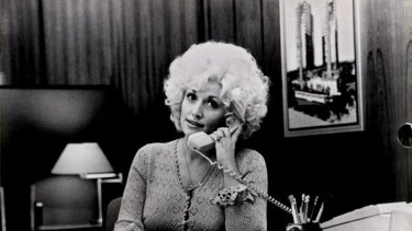 Dolly Parton in a scene from the movie Nine To Five 1986 PIC - FAIRFAX FILE