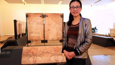 Unique carvings: Curator Cao Yin with marble panels being installed for <em>A Silk Road Saga</em>.